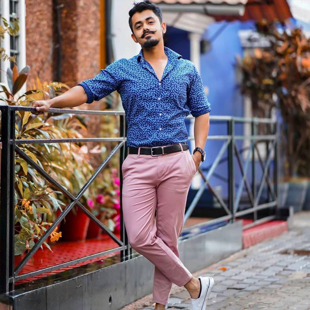 pink chinos paired with blue shirt